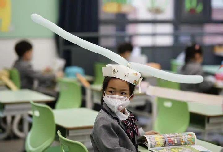 китайские школьники, шапки для дистанции