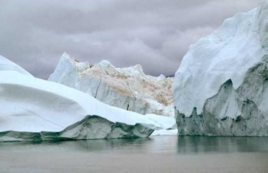 В глобальном потеплении частично  виновато таяние льдов  Гренландии