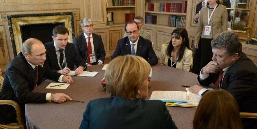 Путин, Порошенко и Меркель на многосторонней встрече в Милане / Фото: ТАСС