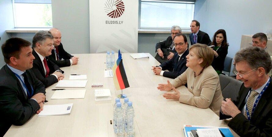 Франсуа Олланд, Петр Порошенко и Ангела Меркель / Фото пресс-службы президента Украины