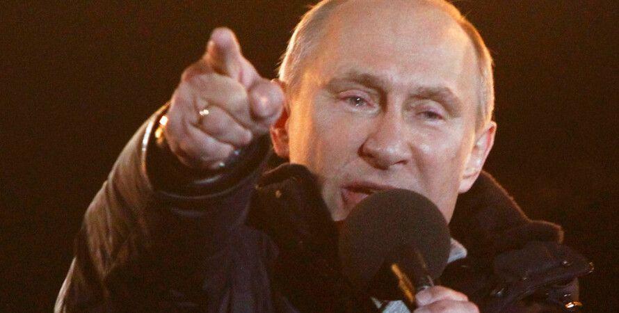 Владимир Путин на Манежной площади во время президентской кампании / Фото: Reuters