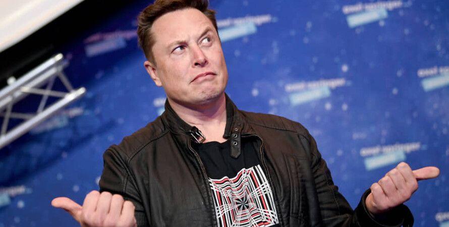 Tesla и Илон Маск - фото