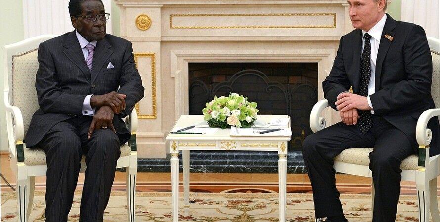 Путин и Мугабе / Фото пресс-службы Кремля
