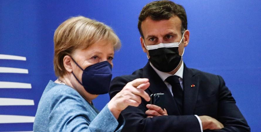 Ангела Меркель и Эмманюэль Макрон в масках