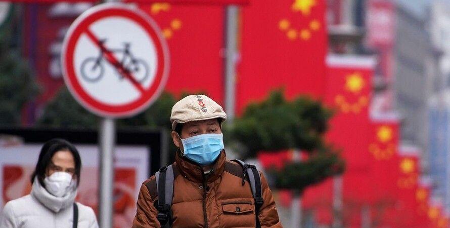 Китай, коронавірус, тести, які в'їжджають, анальний мазок,