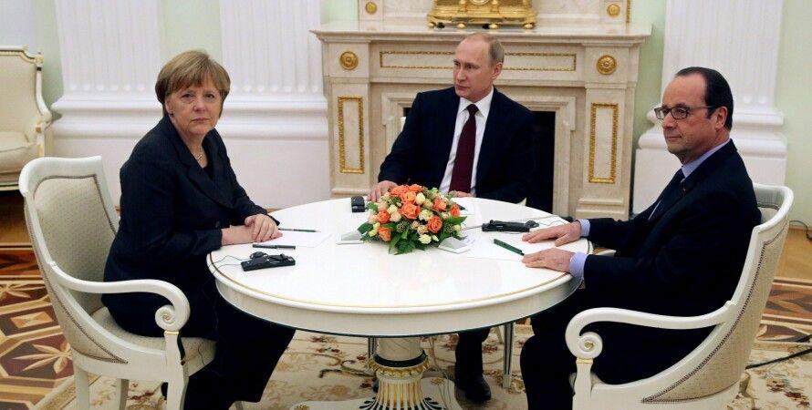 Меркель, Путин и Олланд в Москве / Фото: Getty Images