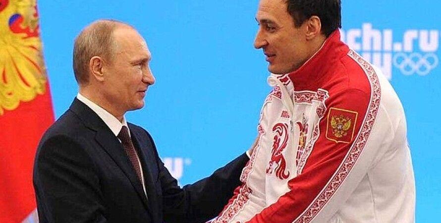 Владимир Путин и Алексей Воевода / Фото: НОК РФ