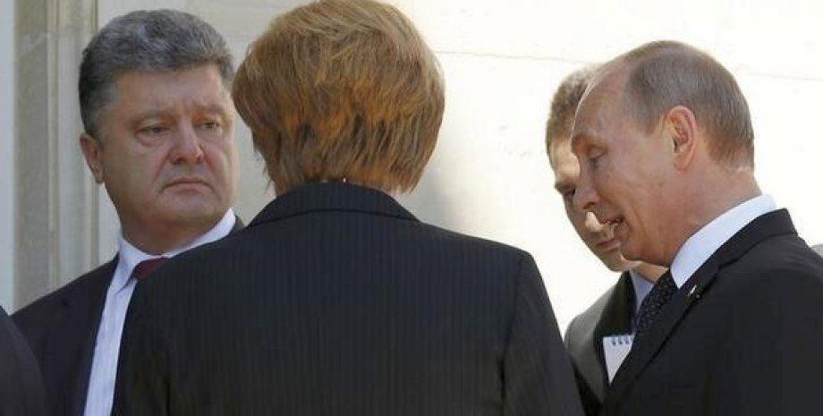 Порошенко, Меркель и Путин в Нормандии / REUTERS