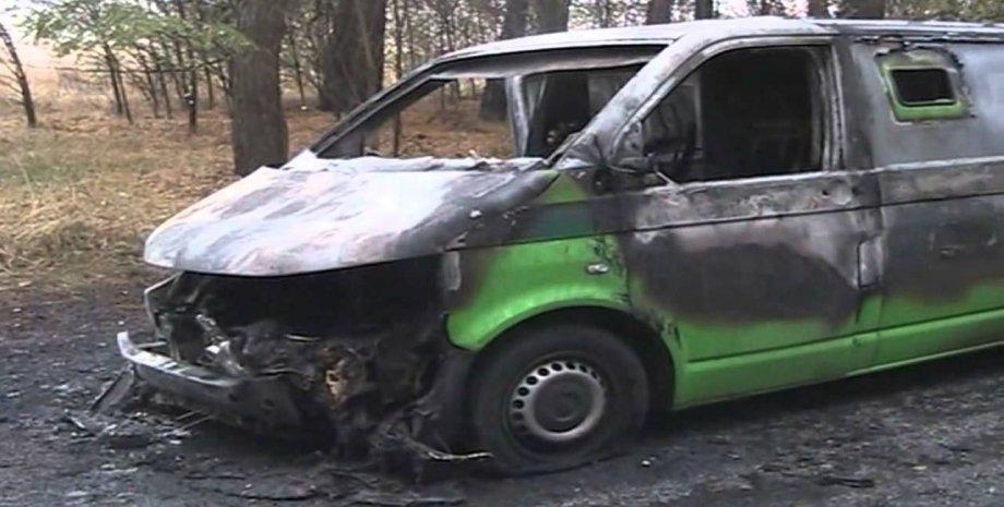 Сожженная машина инкассаторов / Фото: Укринформ