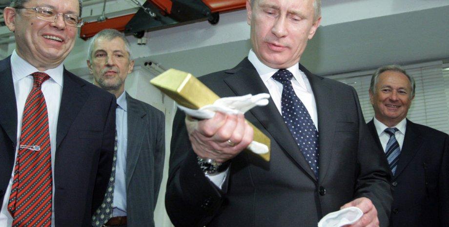 Владимир Путин и золотой запас России / Фото: Bloomberg
